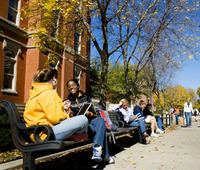 Students on benches at the University of Iowa
